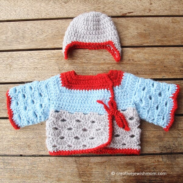 Crocheted Baby Sweater With Scallop Stitch