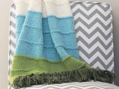 KNIT MULTI COLORED BLANKET