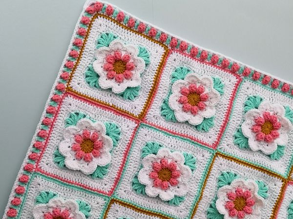Crochet Baby Girl blanket with 3D flowers free pattern